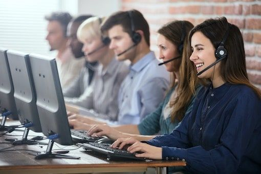 Line of callcenter agents in front of computers